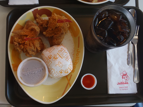 "bird's eye view of a tray of fast food at ""Jollibee"""