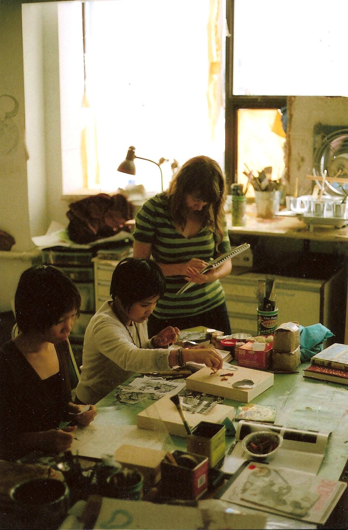 Lyndel and Michaela in an encaustic collage workshop with Leah Gold