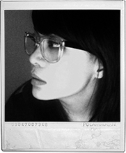 christine mangosing in black and white polaroid wearing thick-framed glasses