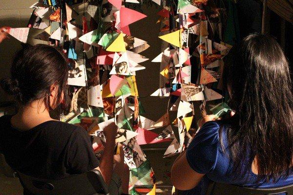 Photo of volunteers working on festival flags or banderitas