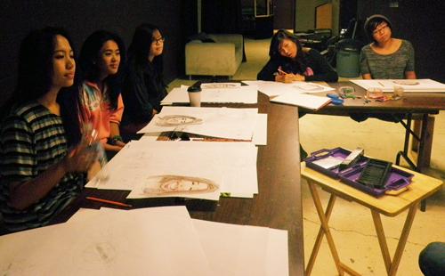 Girls engaged in portraiture workshop