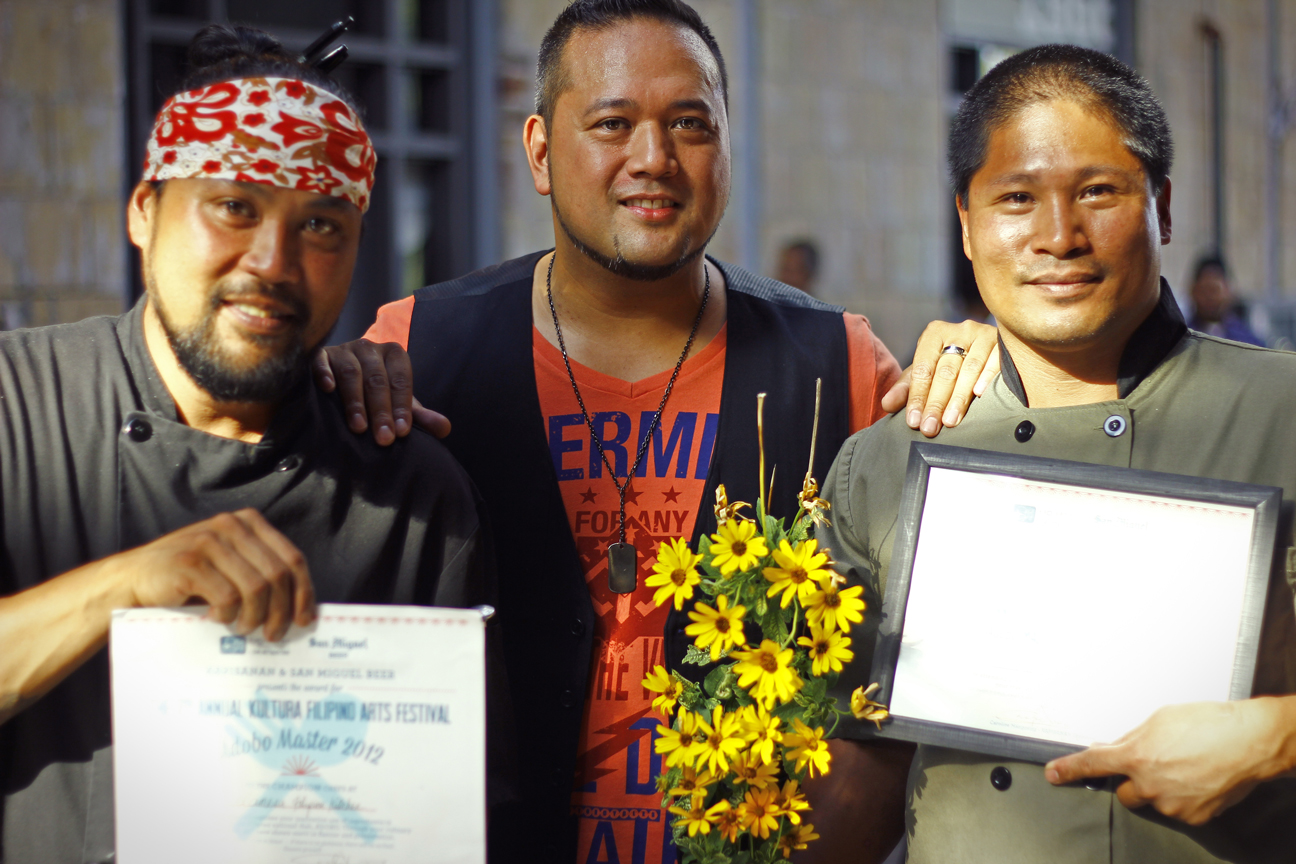 L-R Rudy Boquila from Lamesa Filipino Kitchen, the winner of KULTURA 2012's Adobo Masters Cook-Off, Ron Josol, the judge for the competition, and Charles Alconcel of Adobo Cafe, the winner of People's Choice Adobo Award