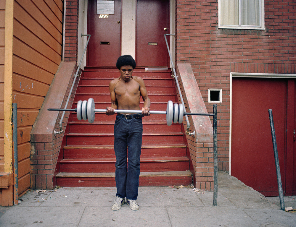 Photo By Janet Delaney- Boy lifting weights, 122 Langton Street