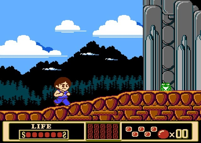 This image captures it all. Look how angry Jackie is, and look how blithely oblivious the frog is. Little does it know it's about to get a jump-kick powerup punched right out of its stupid mouth. (NES Version)