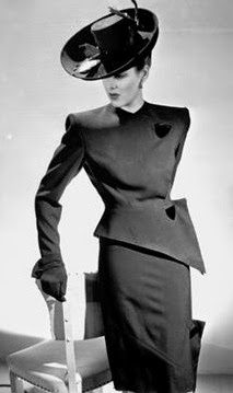 1940s+fashions+with+dramatic+use+of+shoulder+pads.jpg