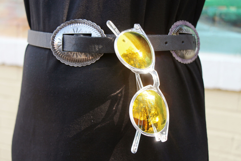 mirrored sunnies  and conch shell belts