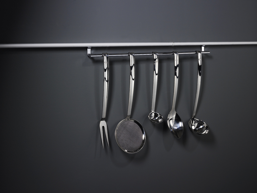 "Design creates order. Or perhaps, in the case of LINERO 2000 railing systems, order creates design. This full line of innovative storage accessories was created for the cook who prefers to keep every kitchen necessity close at hand. From our most popular cook book holder...to whisks, knives and small appliances. Even oils and spices. An assortment of stylish accessories takes the LINERO 2000 from ""practical"" to ""beautiful.""  Ordinarily, you might assume it's necessary to open cabinets and drawers to find the kitchen tools you need. With a BACKSPLASH SYSTEM from Kesseböhmer, cooking utensils and more are in plain sight and right at hand. Choose from a huge selection. Sturdy mounting rails keep a low profile against walls and concealed connections add streamlined style."