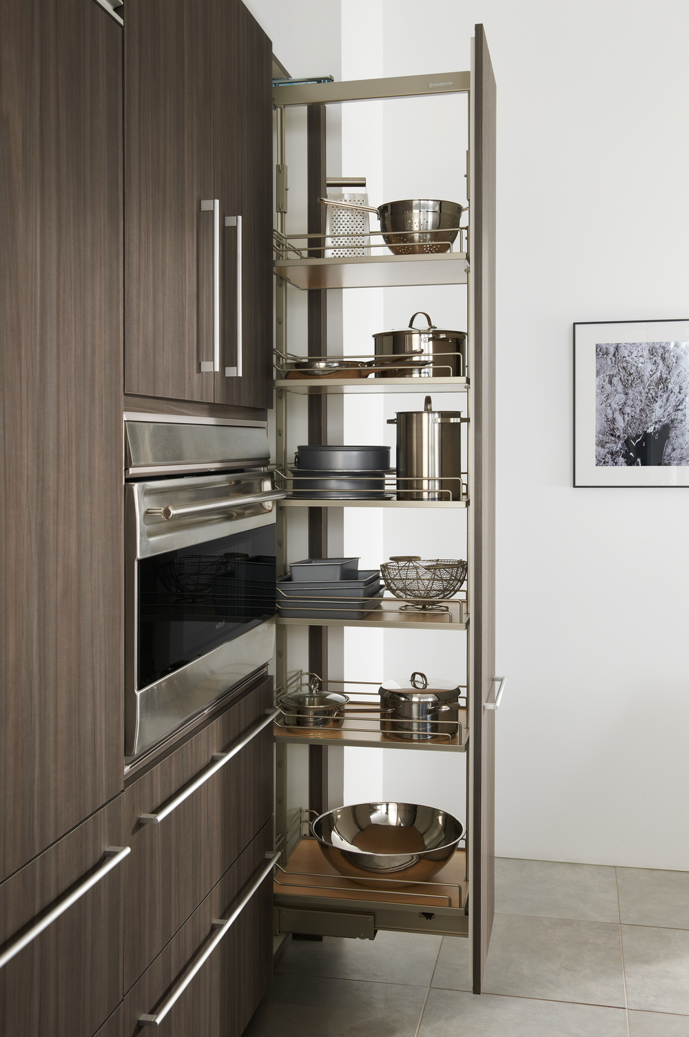Even the most unlikely spaces can become storage superstars with DISPENSA. Perfect for utilizing the complete width and height of tall cabinets, DISPENSA slides out to make sure not one speck of space is wasted. Individually suspended and adjustable shelves feature simple railings that keep everything in its place – and in plain view, too.