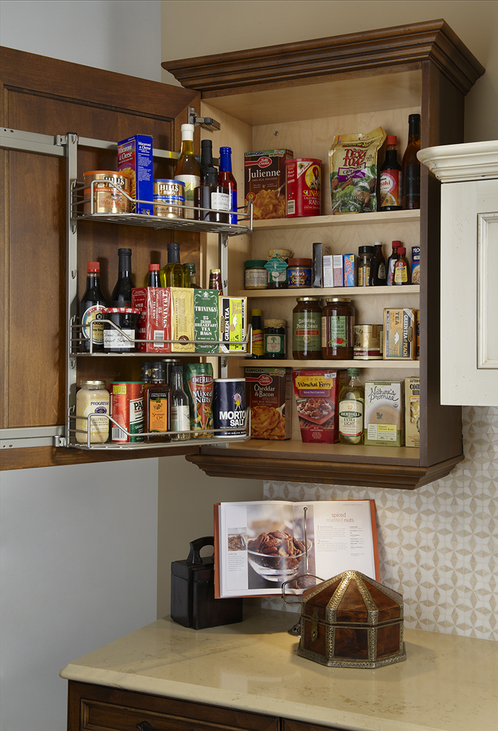 Access twice as much,twice as fast with the innovative TANDEM Pantry Pull-Out. One pull of the door and the intelligently-designed shelves at the rear automatically come toward the user – for instant gratification. Inside-door shelves make organization easy for everybody and keep often used items right at hand. You can even use two TANDEMS in one kitchen cabinet to maximize your storage capacity.