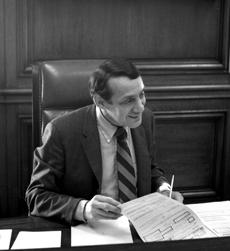 Harvey Milk in 1978 at Mayor Moscone's Desk.