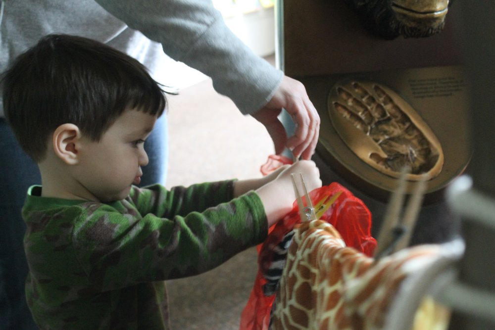 Little fingers got their workout at LEAP--from hanging scarves with clothespins to turning the pages of a good book