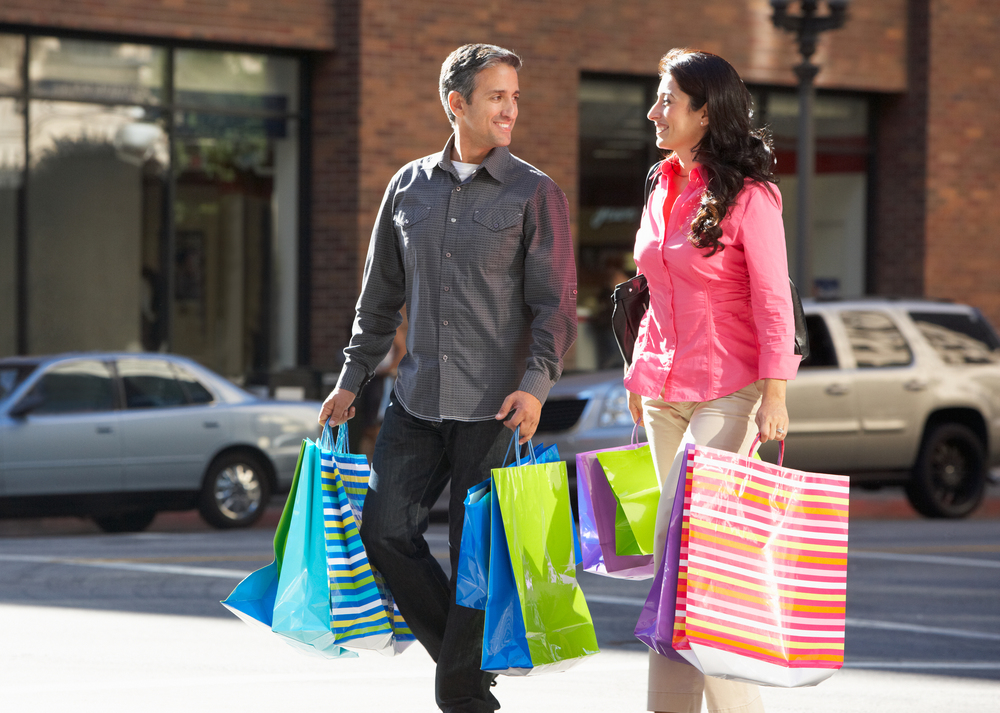 bigstock-Couple-Carrying-Shopping-Bags-44729062.jpg