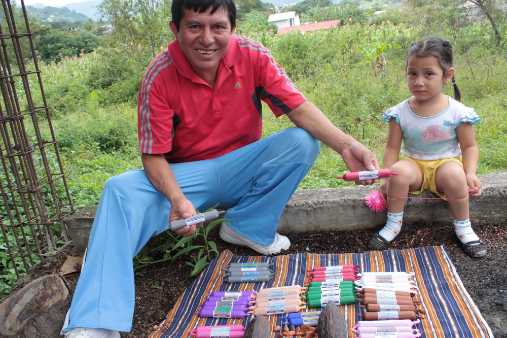 Diego and his daughter show off their creations