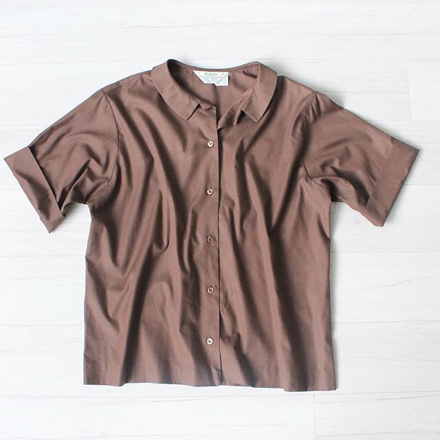 "$20 + s&h vintage 1960s short sleeve button up blouse, brown, cotton material, cuffed sleeves, small brown buttons, great condition, sz: medium/large bust: 44"" waist: 42"" bottom hem: 42"" shoulders: 17"" sleeve length: 9"" total length: 24"" cuff circumference: 14""  #vintage #vintagestyle #vintagefashion #fall #brown #vintageshirt #60sfashion #wardrobestaple"