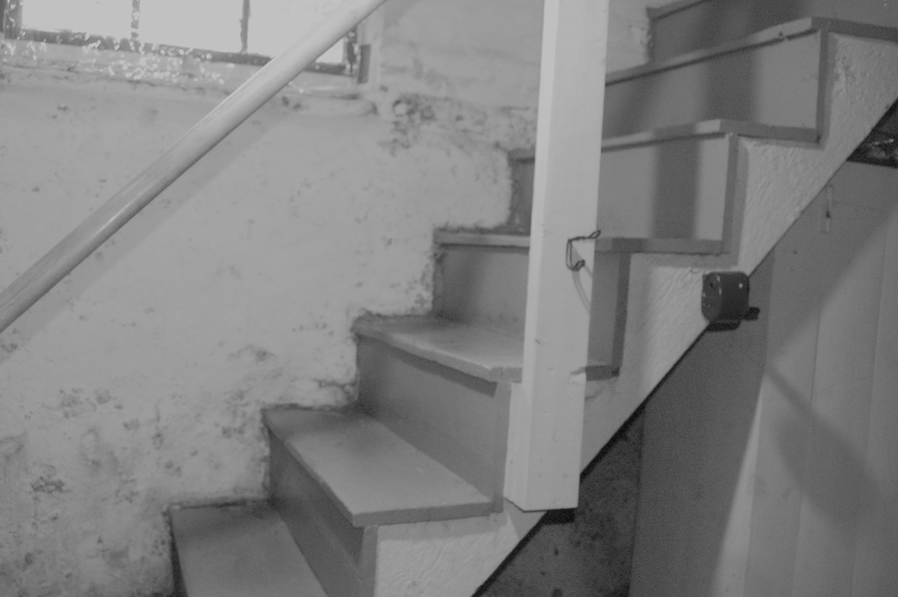 Empty staircase with creepy shadows