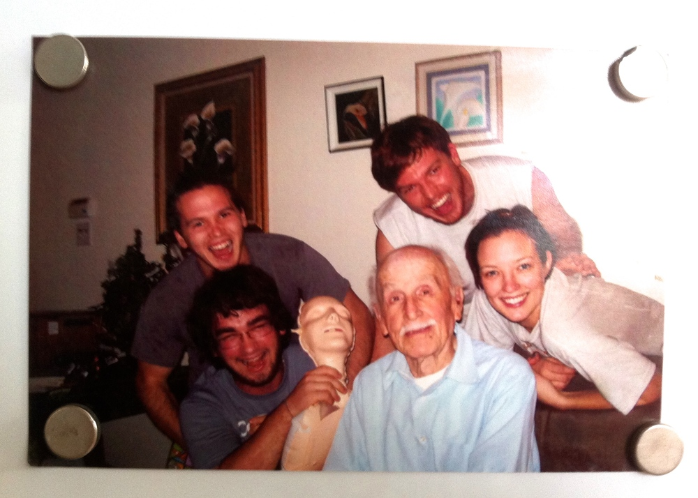 Grandpa is immortal – on the refrigerator. That's my cousin Phillip holding the CPR doll. I'm in the muscle shirt.