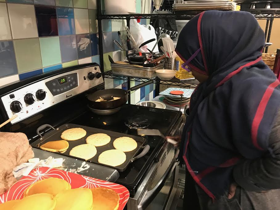 Hawa Jama making her very popular pumpkin spice pancakes