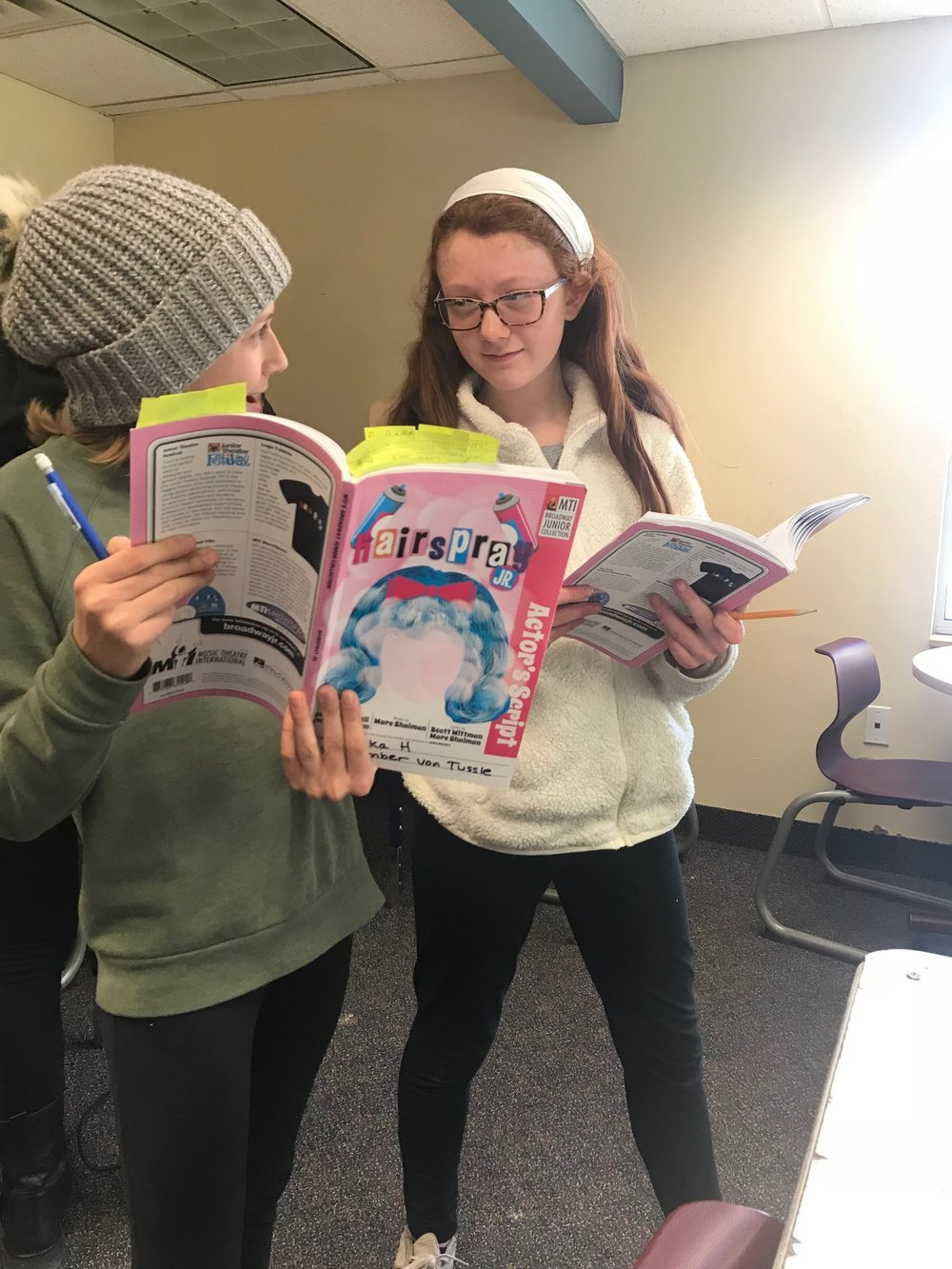 A1 students Annika and Shannon read through their scripts in the first week of rehearsals for Hairspray Jr.
