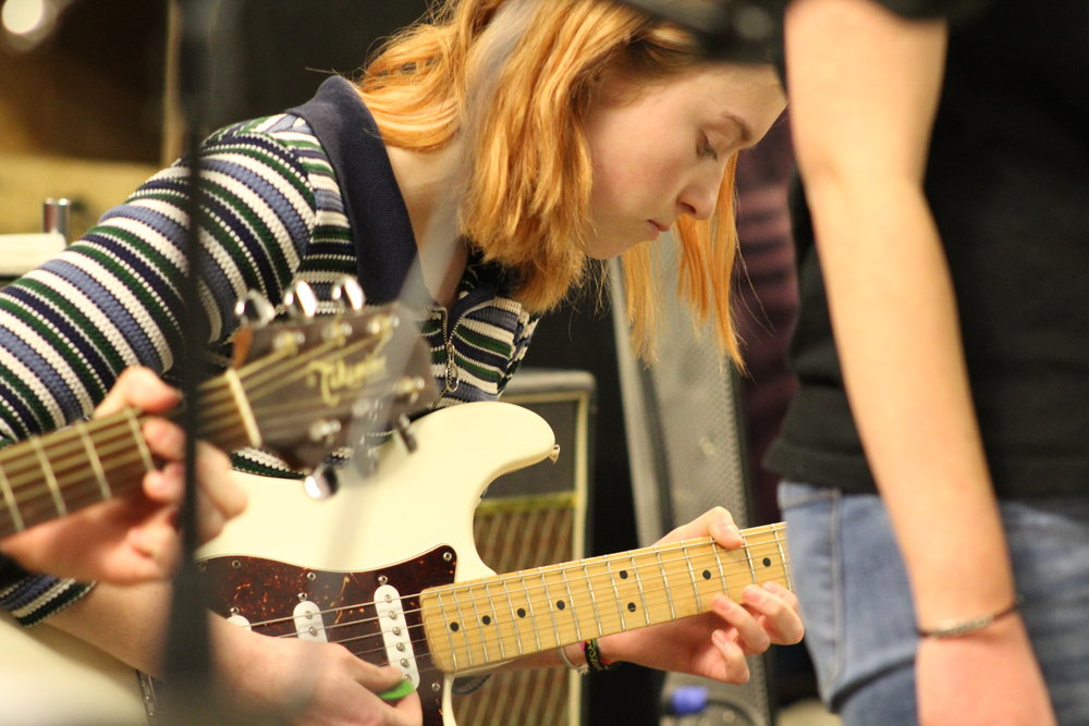 Senior Sophie Dahl plays guitar during the January 19th concert