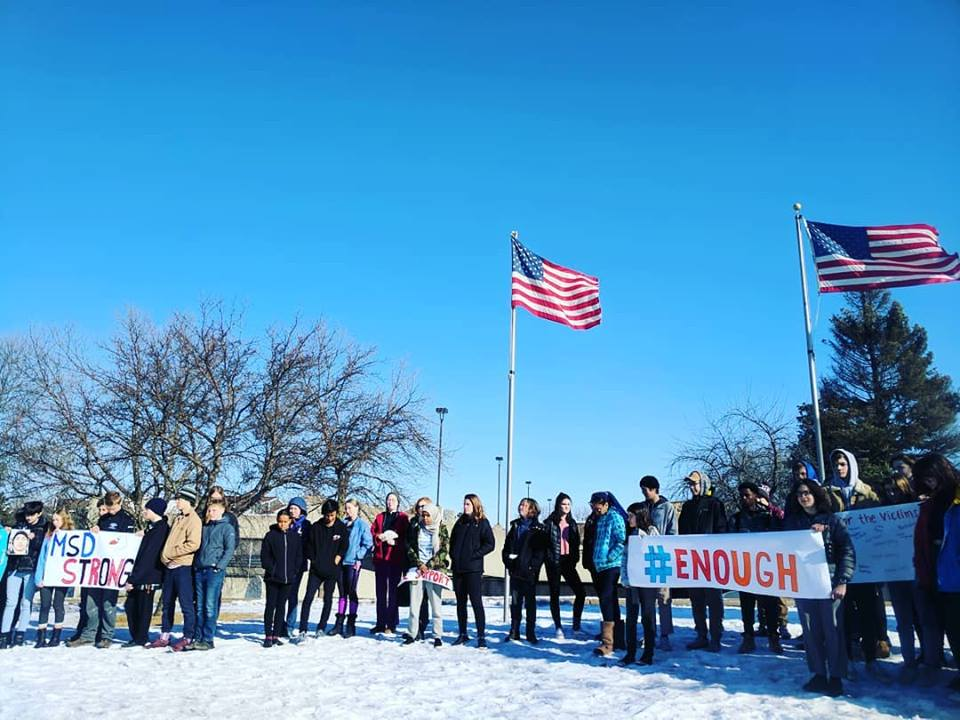 Students participating in a walkout organized by SfSC (March 14th, 2018). Students who chose to participate in the walkout left school and gathered by Energy Park Drive for seventeen minutes to honor those killed in Parkland, Florida.