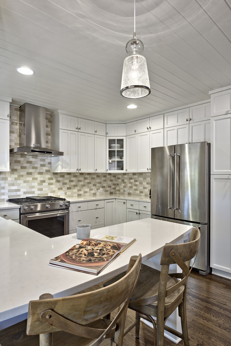 The bead board on the kitchen ceiling was painted a crisp white to give this craftsman style detail a fresh face-lift.