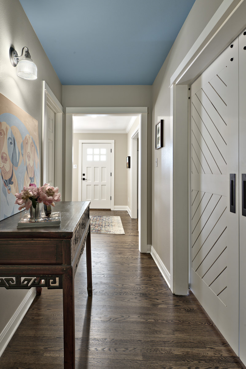 The ceiling in the hallway was painted a sky blue to add a bit of whimsy in-between each room.