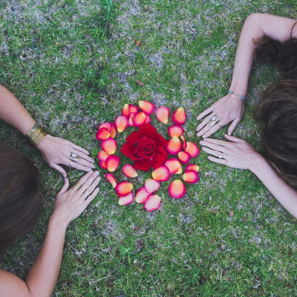 priestesses rose hands on earth.jpg