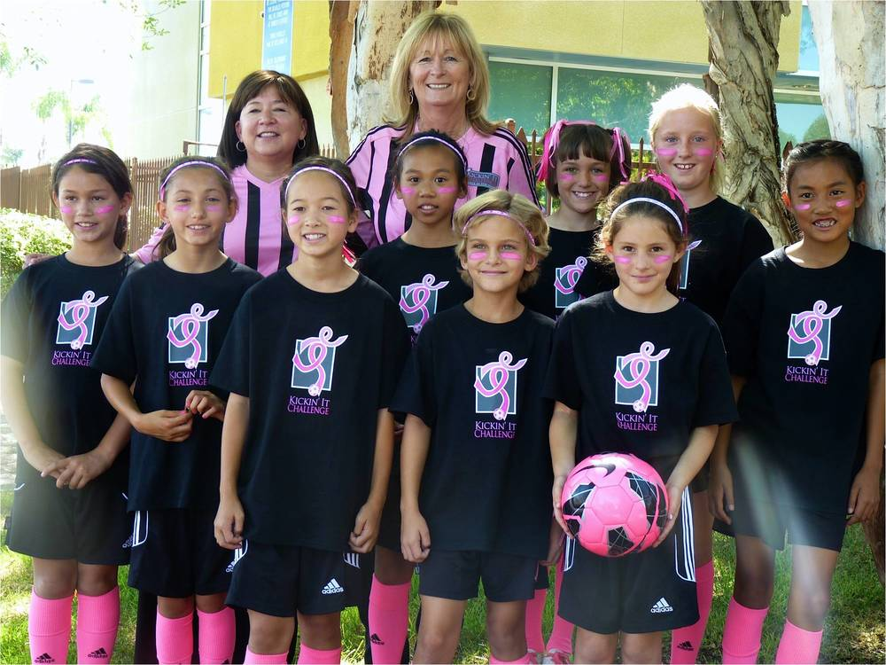 2013 - Pam Bickel, Kickin' It Challenge founder, and Tiffany Quackenbush, coach and breast cancer survivor, with the Poway Vaqueros GU10 Green team at a local news station.