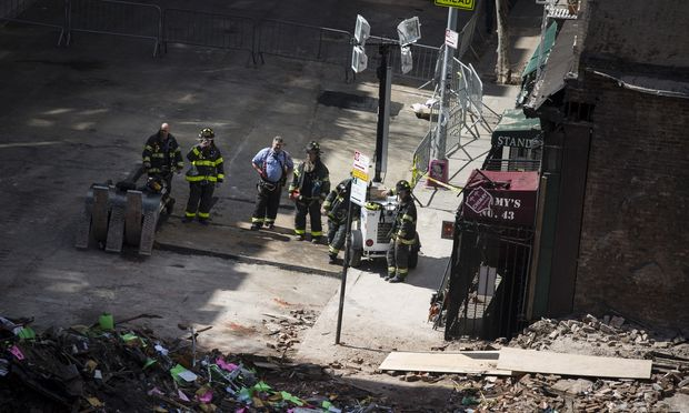 A view from the corner of 2nd Avenue and 7th Street after the adjacent buildings collapsed. Emergency workers beginning to clear debris. (photo by John Taggert)
