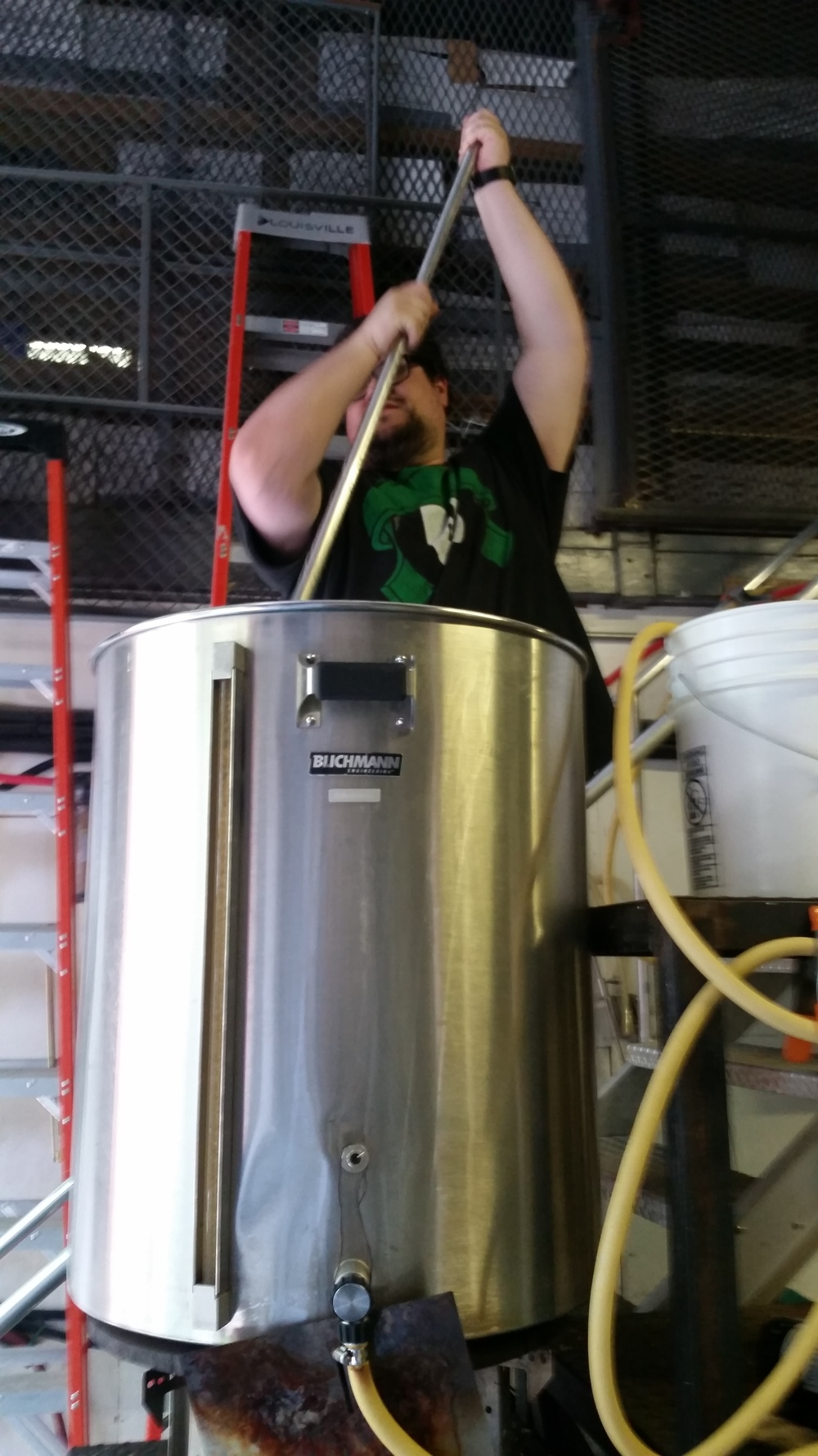 Brian Pope stirring the mash on brew day at Folksbier.