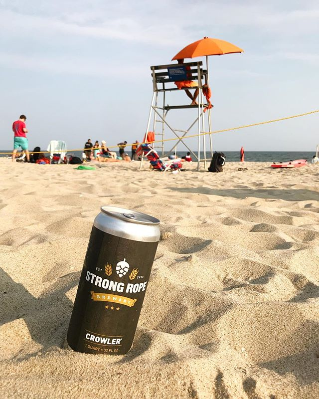 Enjoying a @strongropebrewery Fury of the Gentle Wolf IPA on the beach. Wish you were here!