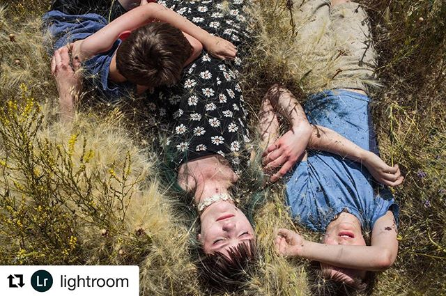 #Repost @lightroom ・・・ Photo by @sarahblesener for #AdobeRisingStars || I want to introduce you to Curtis, Kate, and Jude. Here, the siblings lay in their backyard in Watford, North Dakota. When the sun begins to set in the distance, the flares of oil rigs dance in the orange sky. Western North Dakota attracted families from across the nation during the recent oil boom. Watford, like other rural towns in the region, is now facing unemployment and overdevelopment since the decline of the oil industry.