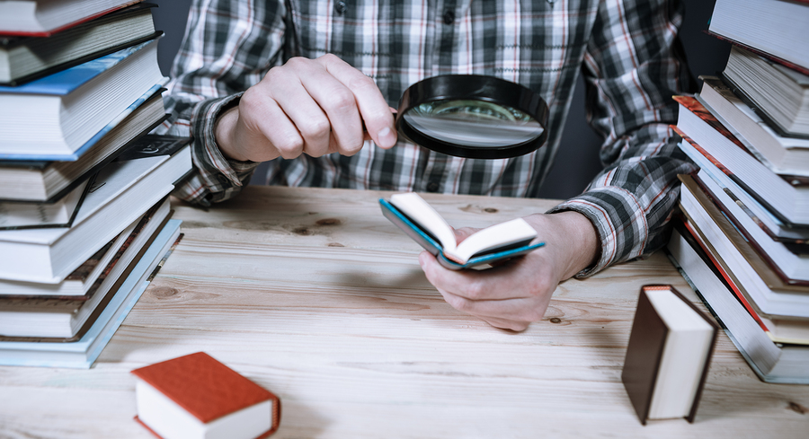 bigstock-A-Man-Reading-A-Miniature-Book-230902672.jpg