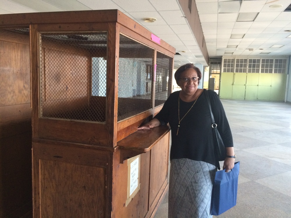 Yvonne Smith reenacts the process of buying SEPTA tokens from a booth in the cafeteria when she attended Bok Vocational Technical High School in the 1960s.