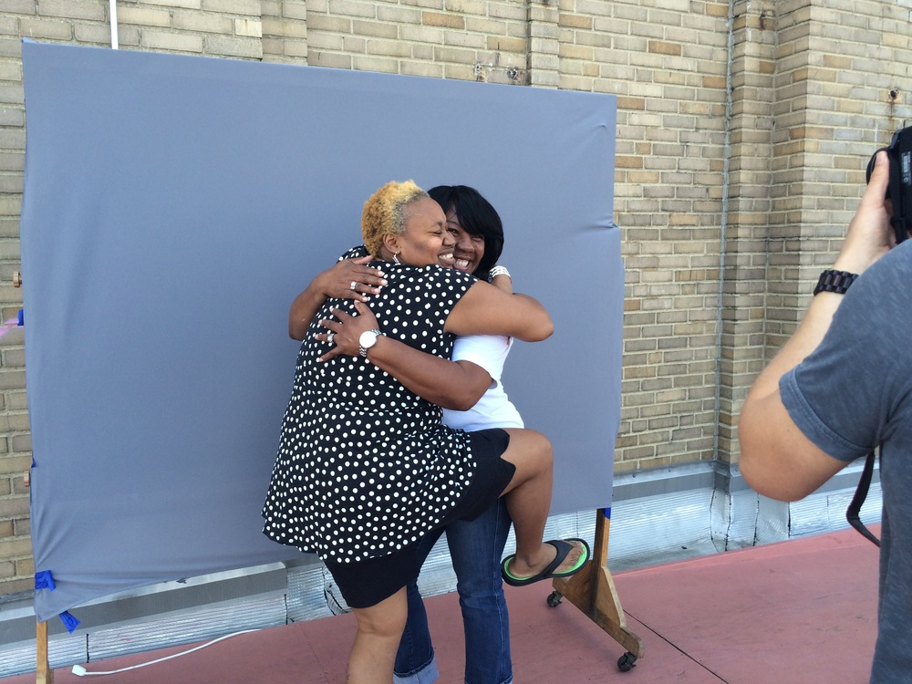 RaMonda Crosby and Kisha Harden, Bok High School alumni from the Class of 1989, pose in a hug for their Storycorps picture.