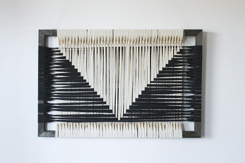 Black and white graphic woven recycled textile art.