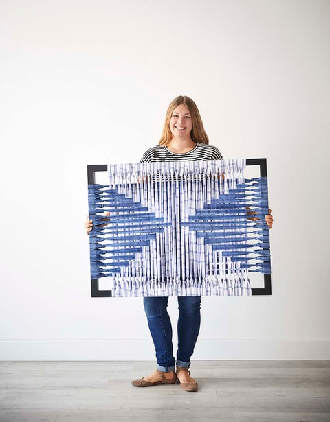 Jamie holding a piece made with Unison Home Deadstock Materials, Hand dyed with indigo.