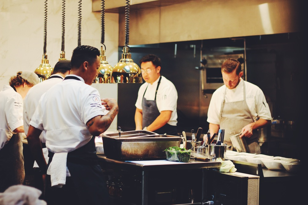 Chef Esteban, Chef Chris, and team in the kitchen whipping up for their guests.