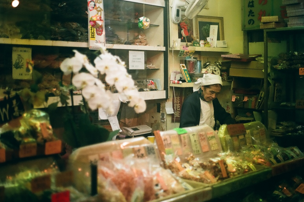 I love this shot of this Japanese elder running her little shop.