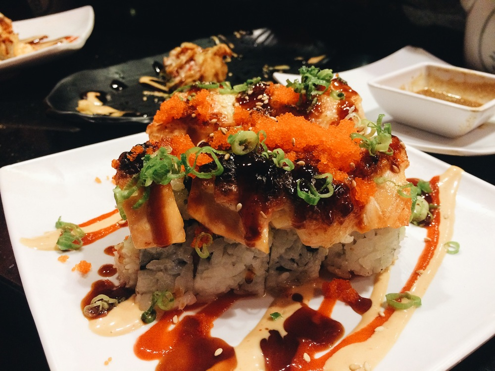 """I randomly ordered this, Awesome Roll. I didn't know it was cooked tuna on top, I should've read the menu but I HATE cooked fish. I managed to finish most of it, I was pretty full by the time I got this. This right here, is what I meant when I say """"doing too much."""" But hey, some people love it, I know I used to love it."""