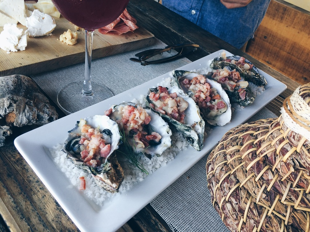 Oysters topped with baked bacon.