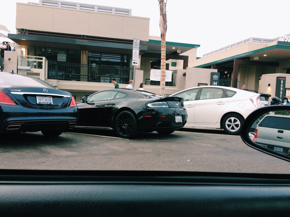 On my way out of La Jolla in my race car, I spotted this Aston. Black beauty.
