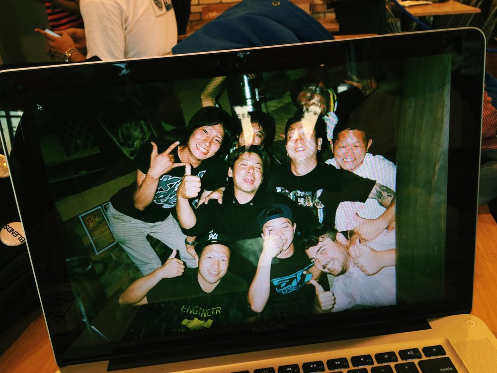 A bunch of drunk Asians, if you're a car guy you might recognize some of these Japanese dudes. Not your average Joes.
