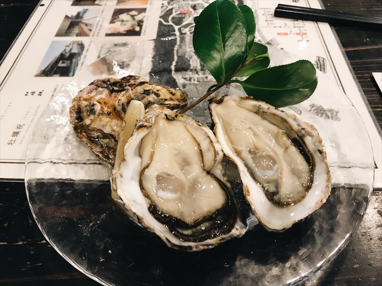 Two raw oysters, no sauce just lemon. Tasted oysters by itself for the first time and it was goooooodd. Normally I would use Tabasco and shit on the oysters back at home.