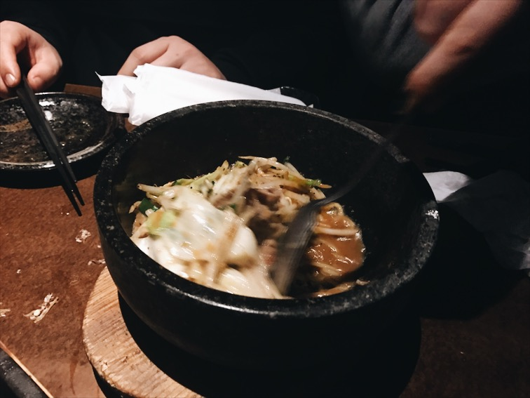 Some beef and noodles in a extremely hot bowl.