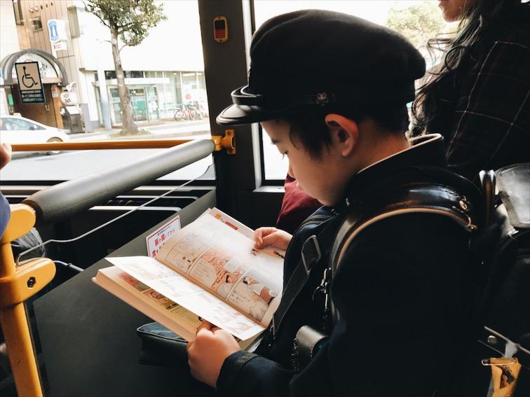 "This kid walked up to my seat, stared at me. He was so cute! So I asked him ""do you want to sit here?"" He replied ""yes."" He speaks a little english. Then he asked, ""are you Japanese?"" I replied, ""no, but here, have a seat."""