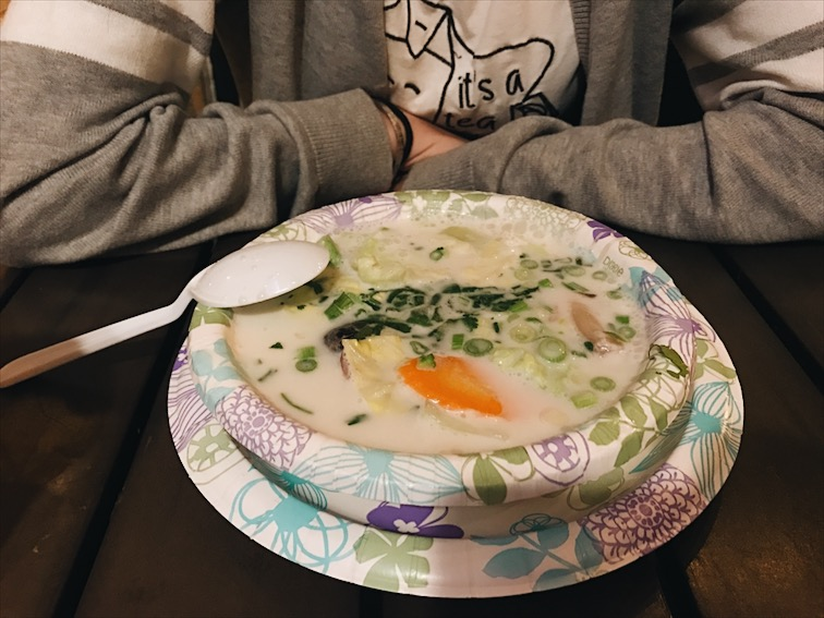 "Tom Kha, Lupita had Tom Yum before so she's a little familiar with this soup but she was thrown off by the Coconut milk this time. She was confused of the flavors, said she can taste the tangy and then the sweet from the coconut milk sneaks up quick. I call it the ""Bowl Of Argument."" Cuz you're like ""oh its tangy, NOPE! it's sweet!"" This was really good though, I love how the veggies were cooked too."