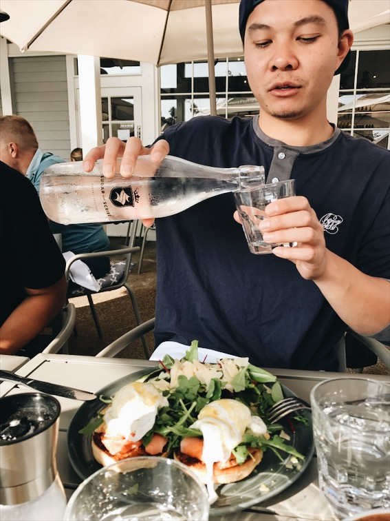 Table etiquette, pouring water for others.