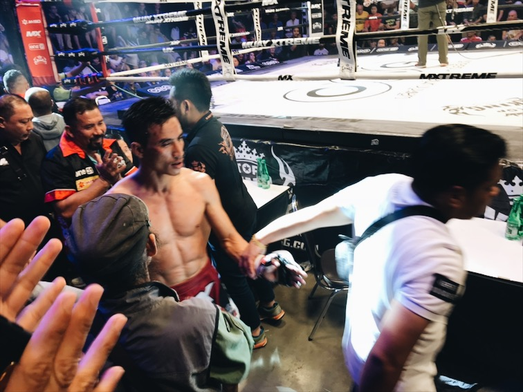 This guy got poked in the eye by a Cambodian fighter. All the Thai people wanted to jump in the fight lol. It was fucking intense!!