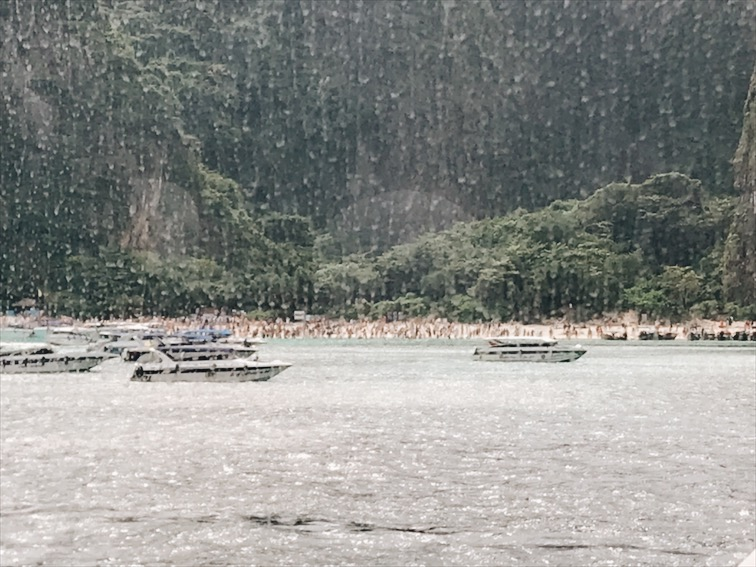 """I didn't want to step out to take this photo cuz I feeling sick so I shot this through my window. The tour said """"look to the left"""" and I'm like, what is there to look at? lol.. Humans on the beach and small boats everywhere."""